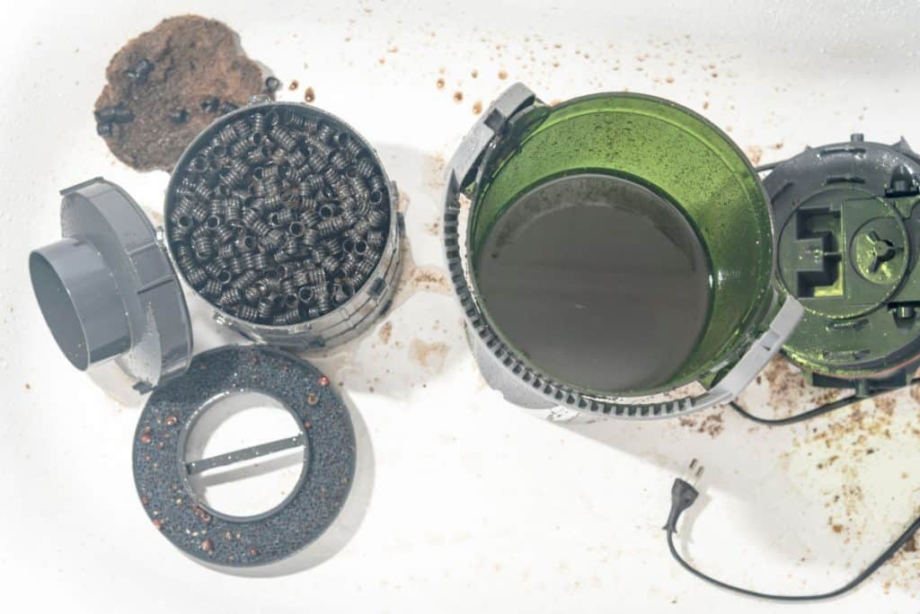 A canister filter taken apart showing the insides and workings
