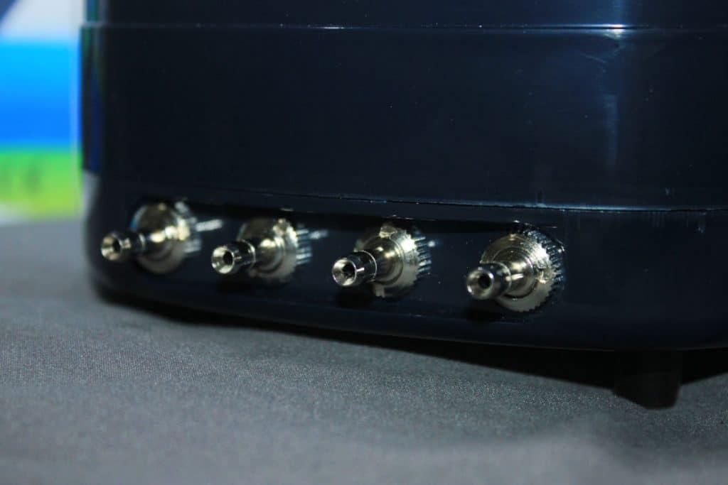 Close up of four aquarium air pump outputs