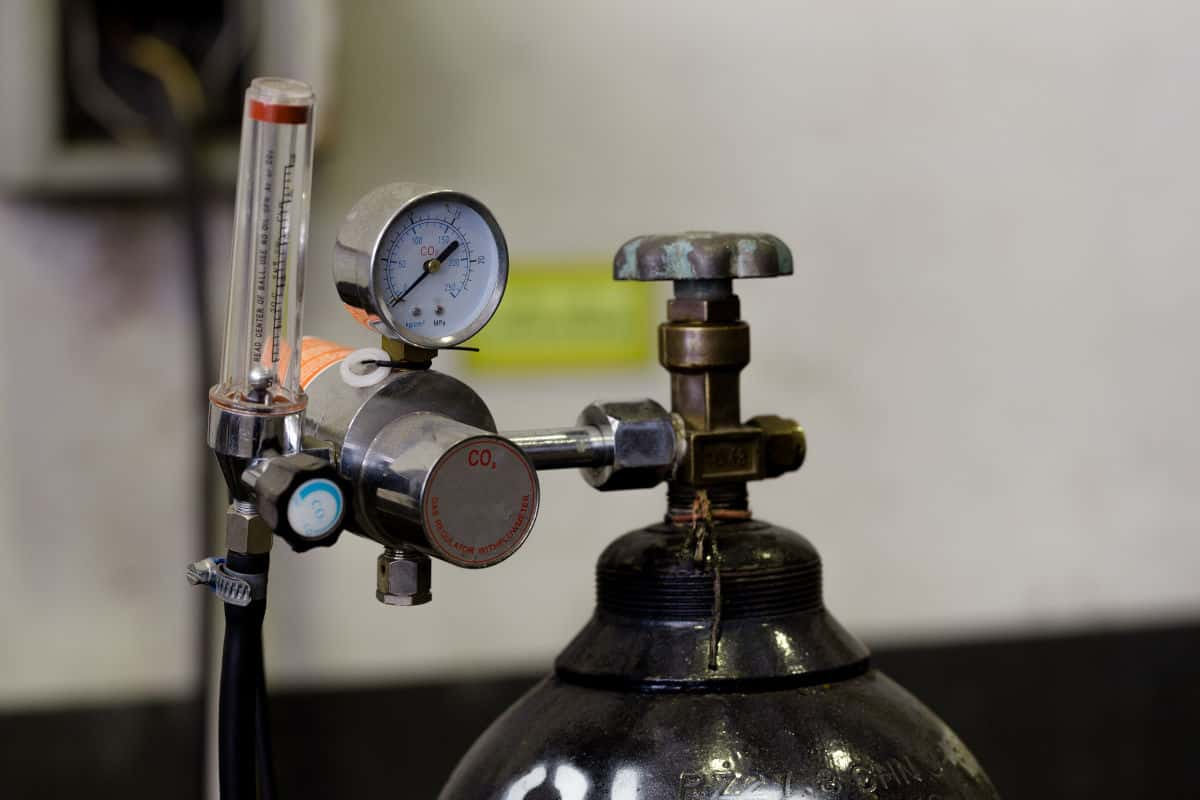 Top of a CO2 cylinder with a regulator attached
