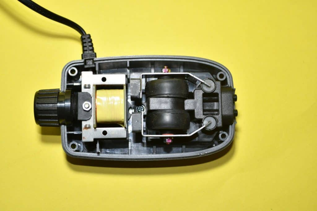 Top view of an aquarium air pump with the case removed to see how it works